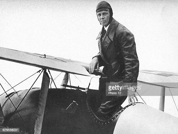 Charles Lindbergh in his flying kit standing by 'Spirit of St Louis' the plane in which he made the first nonstop Atlantic air crossing 2021 May 1927...