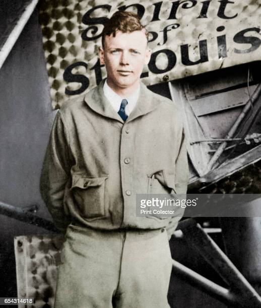 Charles Lindbergh in his flying kit standing by Spirit of St Louis the plane in which he made the first nonstop Atlantic air crossing 2021 May 1927...