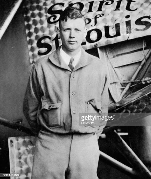 Charles Lindbergh in his flying kit standing by the 'Spirit of St Louis' the plane in which he made the first nonstop Atlantic air crossing 2021 May...