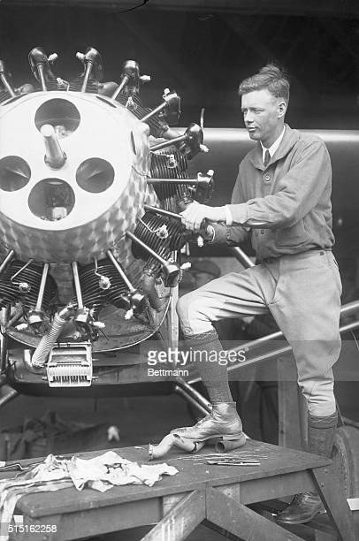 Charles Lindbergh Inspecting Airplane Motor for His Transatlantic Flight