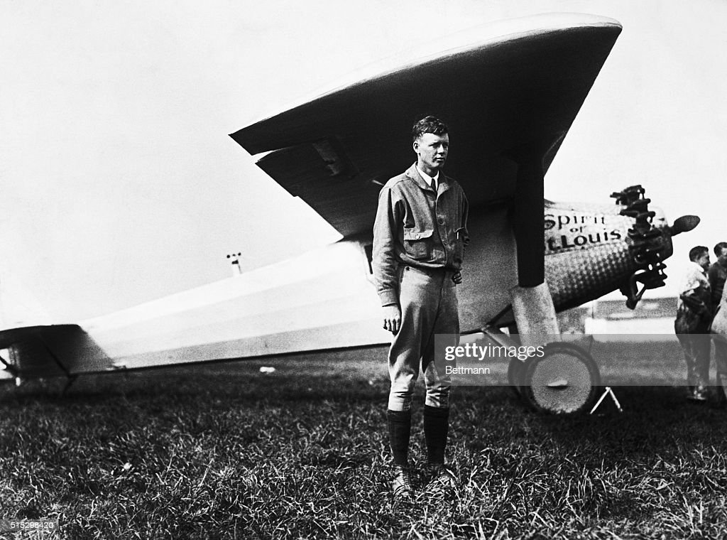 Charles Lindbergh stands in front of the his aircraft, The Spirit of St. Louis, shortly before his solo crossing of the Atlantic ocean.