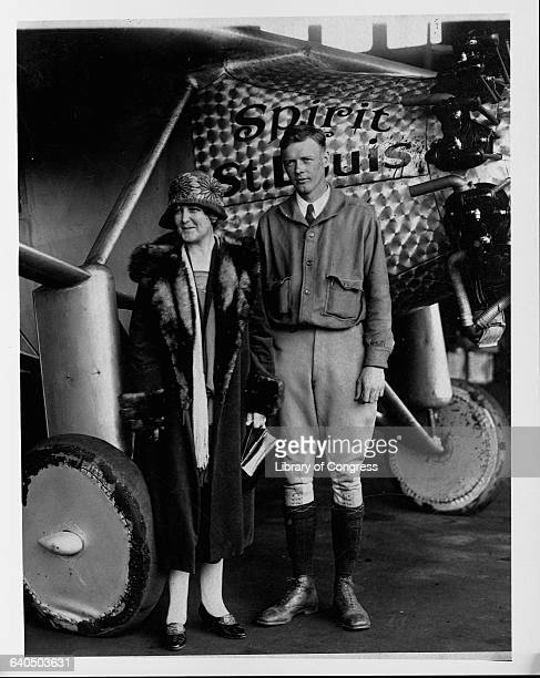 Charles Lindbergh stands next to his mother in front of the Spirit of St. Louis, after he flew solo over the Atlantic Ocean.