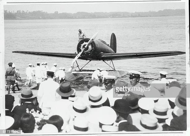 Charles Lindbergh stands on the wing of his Lockheed Sirius following his landing in Kasumigaura northeast of Tokyo Charles and his wife Anne began...