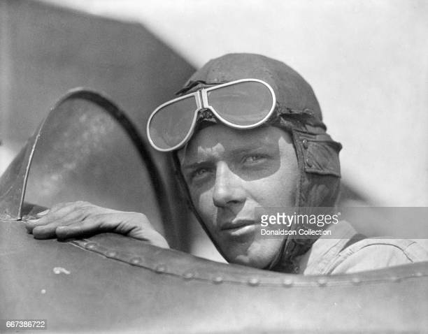 Charles Lindbergh, wearing helmet with goggles up, in open cockpit of airplane at Lambert Field, St. Louis, Missouri in 1923.