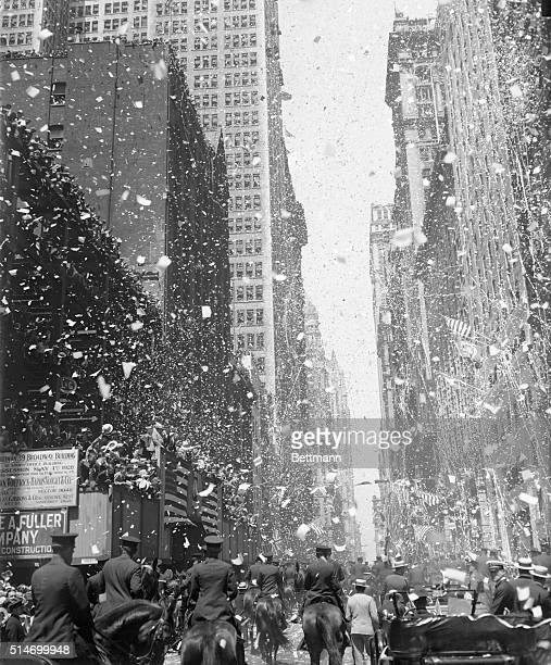 Charles Lindbergh who became the first pilot to complete a nonstop solo flight across the Atlantic is honored with a tickertape parade down Broadway...