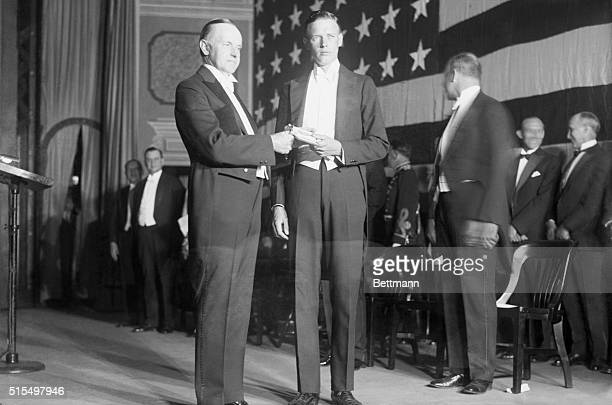 "Charles ""Lindy"" Lindenbergh, Conquerer of the Atlantic ocean, receiving from President Coolidge the Hubbard Gold Medal of the National Geographic..."