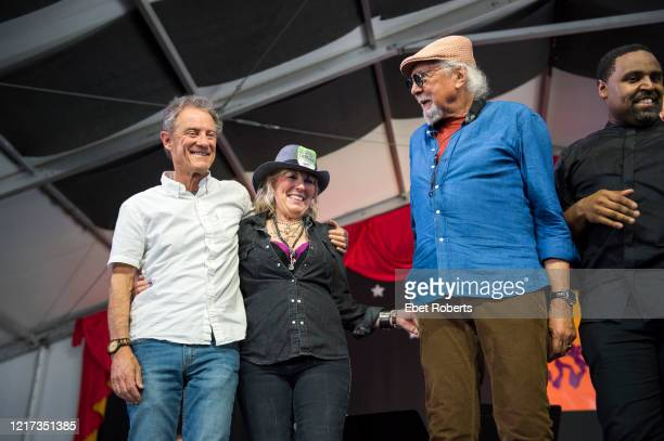Charles Lloyd takes a bow with Lucinda Williams at the New Orleans Jazz Heritage Festival at the Fair Grounds Race Course in New Orleans Louisiana on...