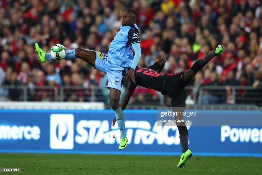 Charles Lokolingoy of Sydney FC and Eddie Nketiah of Arsenal contests the ball during the match between Sydney FC and Arsenal FC at ANZ Stadium on July 13, 2017 in Sydney, Australia.