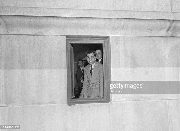 Charles Luciano nicknamed Lucky because he returned alive from a ride is shown smiling as he looks from a window of the detention pen It is seldom...