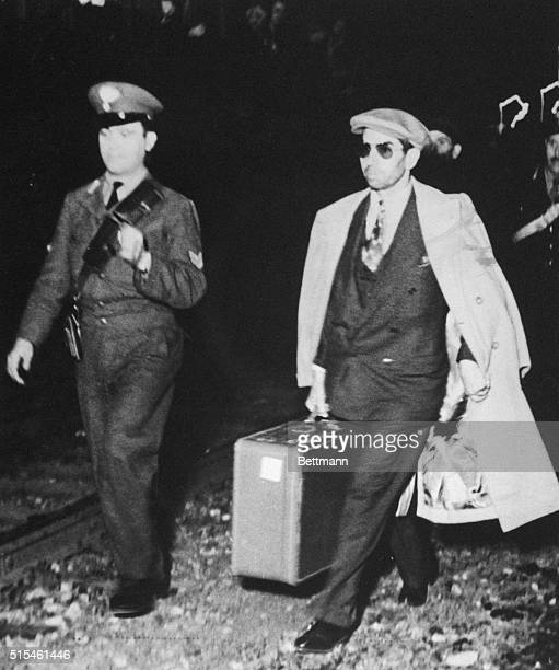 Charles Luciano one time American vice king leaves Genoa under guard of Italian police for return to his native Sicily Luciano who left Italy...