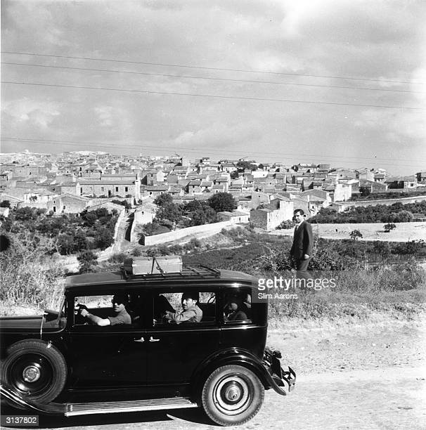 Charles 'Lucky' Luciano and friends in a car while living in Sicily after being exiled from America