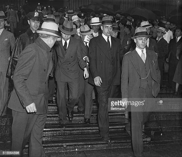 Charles Lucky Luciano convicted as dictator of organized vice in New York City shown second from left with his head slightly lowered as he walked...