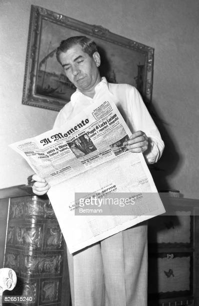 Charles Lucky Luciano shown above reading a Rome newspaper has been named in a Senate Crime Investigating Committee report February 28 as the umpire...