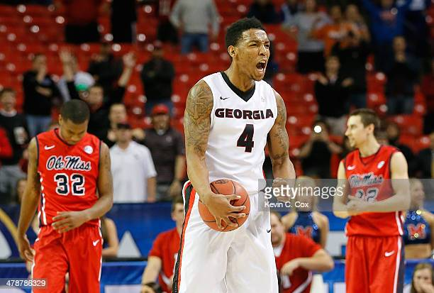 Charles Mann of the Georgia Bulldogs reacts after forcing a turnover by the Mississippi Rebels during the quarterfinals of the SEC Men's Basketball...