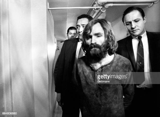 Charles Manson accused leader of a hippie cult charged with the TateLaBianca murders leaves court after deferring a plea on the murder charges The...