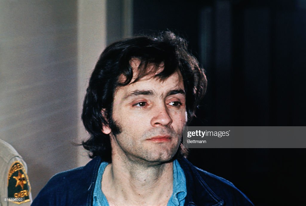 Charles Manson who led a cult that committed murders in Los Angeles in the sixties is clean shaven in closeup photo.