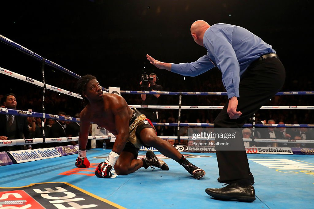 Charles Martin of the United States watches the referee as he counts him out during the IBF World Heavyweight title fight against Anthony Joshua of England at The O2 Arena on April 9, 2016 in London, England.