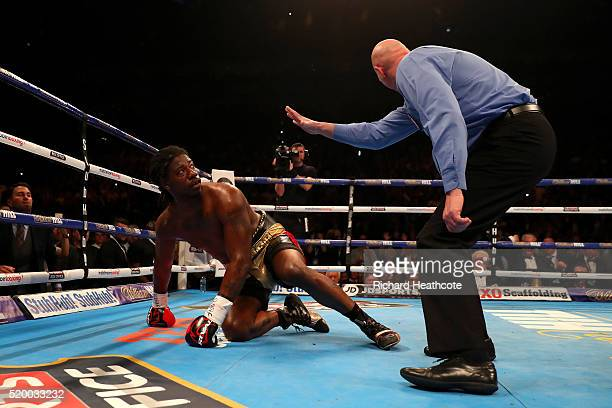 Charles Martin of the United States watches the referee as he counts him out during the IBF World Heavyweight title fight against Anthony Joshua of...