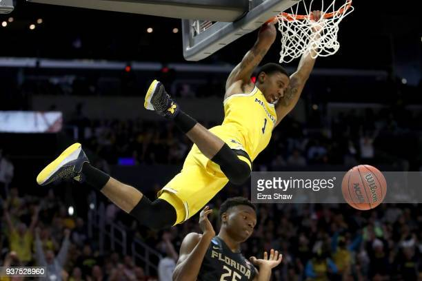 Charles Matthews of the Michigan dunks the ball in the first half against Mfiondu Kabengele of the Florida State Seminoles in the 2018 NCAA Men's...