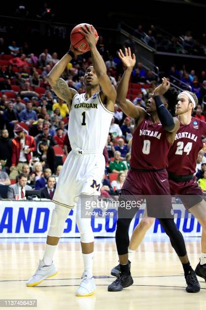 Charles Matthews of the Michigan Wolverines attempts a shot against the Michigan Wolverines in the first half during the first round of the 2019 NCAA...