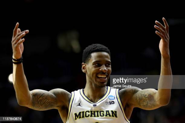 Charles Matthews of the Michigan Wolverines celebrates a basket against the Florida Gators during the second half in the second round game of the...