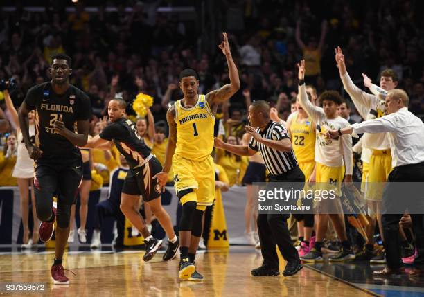 Charles Matthews of the Michigan Wolverines celebrates after sinking a three pointer during the NCAA Division I Men's Championship Elite Eight round...