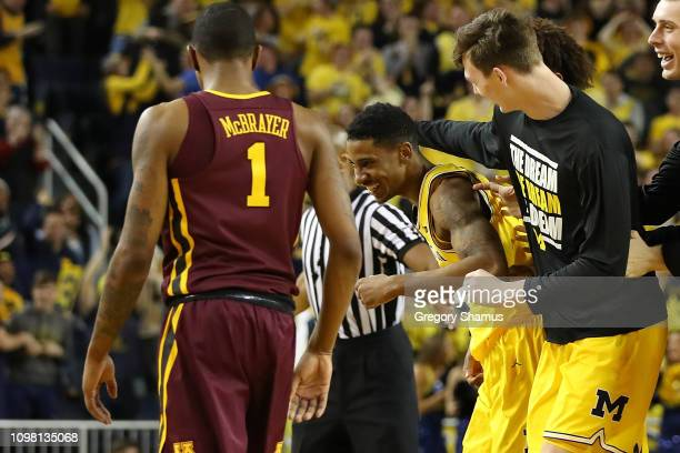 Charles Matthews of the Michigan Wolverines celebrates his buzzer beater game winning shot with Colin Castleton next to Dupree McBrayer of the...