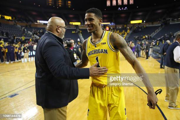 Charles Matthews of the Michigan Wolverines celebrates his buzzer beater game winning shot to beat the Minnesota Golden Gophers 5957 with athletic...