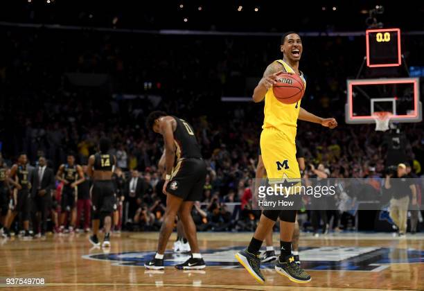 Charles Matthews of the Michigan Wolverines celebrates the Wolverines 5854 win against the Florida State Seminoles in the 2018 NCAA Men's Basketball...
