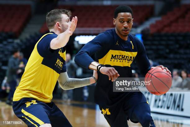 Charles Matthews of the Michigan Wolverines drives to the basket during a practice session ahead of the 2019 NCAA Men's Basketball Tournament West...