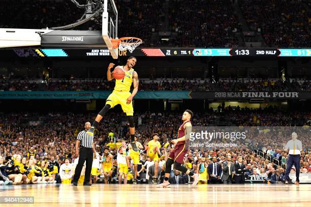 Charles Matthews of the Michigan Wolverines dunks against the Loyola Ramblers during the second half in the 2018 NCAA Photos via Getty Images Men's...