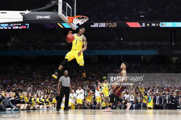 Charles Matthews of the Michigan Wolverines dunks in the second half against the Loyola Ramblers in the 2018 NCAA Men's Final Four semifinal game at...