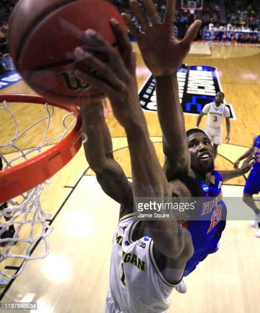 Charles Matthews of the Michigan Wolverines dunks the ball against the Florida Gators during the second half in the second round game of the 2019...