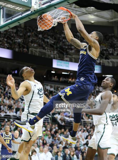 Charles Matthews of the Michigan Wolverines dunks the ball during a game against the Michigan State Spartans at Breslin Center on January 13 2018 in...