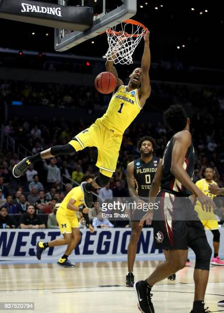 Charles Matthews of the Michigan Wolverines dunks the ball in the first half against the Florida State Seminoles in the 2018 NCAA Men's Basketball...