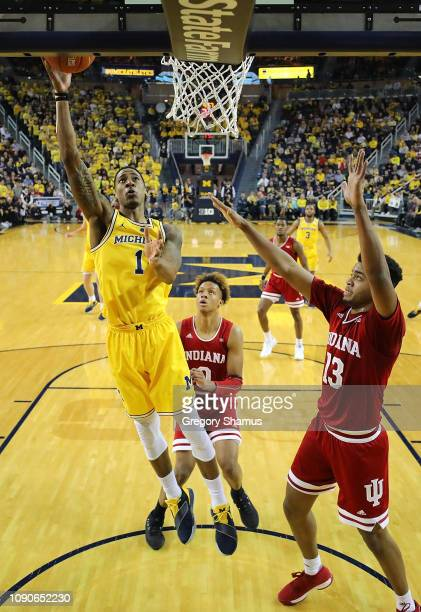 Charles Matthews of the Michigan Wolverines gets to the basket past Juwan Morgan of the Indiana Hoosiers during the second half at Crisler Arena on...
