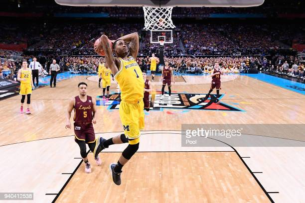 Charles Matthews of the Michigan Wolverines goes up for a dunk in the second half against the Loyola Ramblers in the 2018 NCAA Men's Final Four...