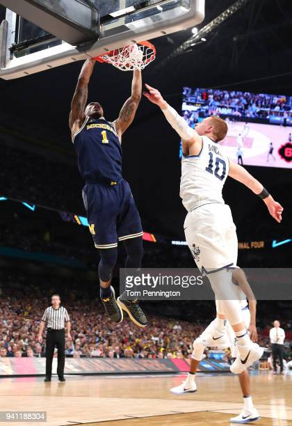 Charles Matthews of the Michigan Wolverines goes up for a dunk in the first half against Donte DiVincenzo of the Villanova Wildcats during the 2018...