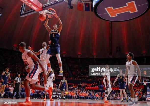 Charles Matthews of the Michigan Wolverines goes up for the dunk during the second half of action against the Illinois Fighting Illini at State Farm...