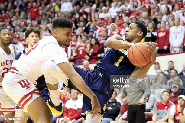 Charles Matthews of the Michigan Wolverines grabs a rebound against the Indiana Hoosiers at Assembly Hall on January 25 2019 in Bloomington Indiana