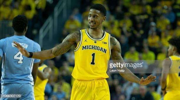 Charles Matthews of the Michigan Wolverines looks to the bench after scoring late in the second half of the game against the North Carolina Tar Heels...