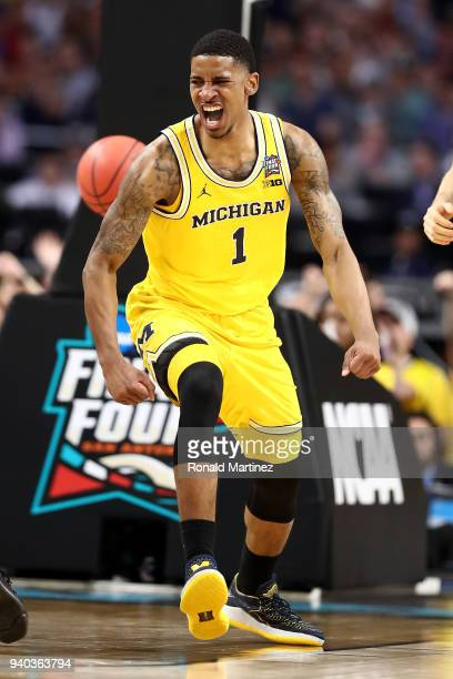Charles Matthews of the Michigan Wolverines reacts after a basket in the second half against the Loyola Ramblers during the 2018 NCAA Men's Final...