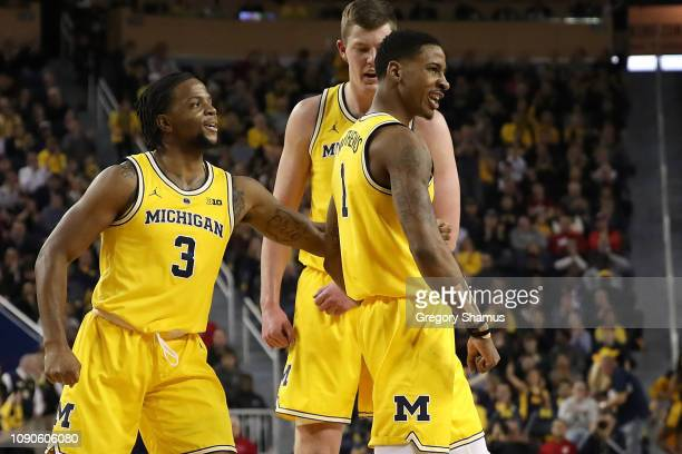 Charles Matthews of the Michigan Wolverines reacts after a first half play wth teammates Zavier Simpson and Jon Teske while playing the Indiana...
