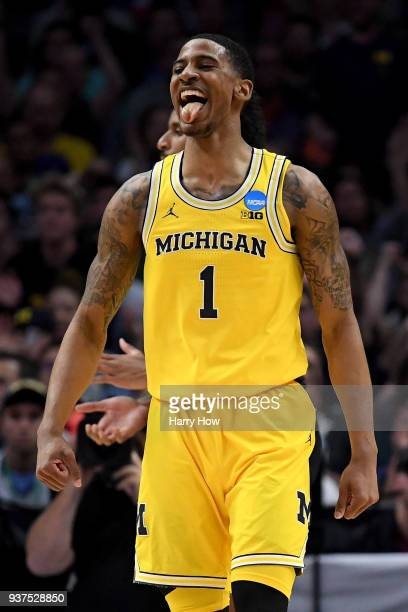 Charles Matthews of the Michigan Wolverines reacts after he dunks the ball in the first half against the Florida State Seminoles in the 2018 NCAA...