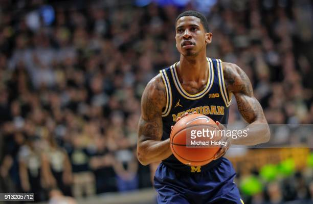 Charles Matthews of the Michigan Wolverines shoots a free throw during the game against the Purdue Boilermakers at Mackey Arena on January 25 2018 in...