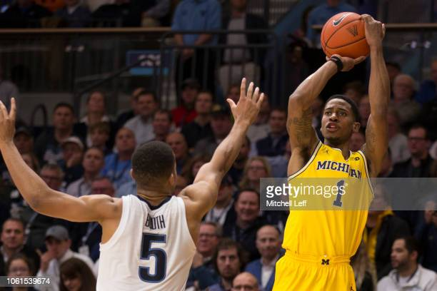 Charles Matthews of the Michigan Wolverines shoots the ball against Phil Booth of the Villanova Wildcats in the second half at Finneran Pavilion on...