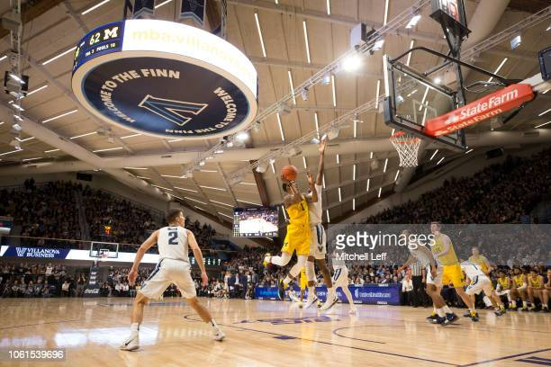 Charles Matthews of the Michigan Wolverines shoots the ball against Saddiq Bey of the Villanova Wildcats in the second half at Finneran Pavilion on...
