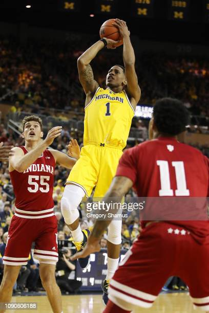 Charles Matthews of the Michigan Wolverines takes a jump shot next to Evan Fitzner of the Indiana Hoosiers during the first half at Crisler Arena on...