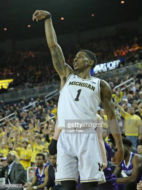 Charles Matthews of the Michigan Wolverines watches his three point shot during the first half of the game agains the Holy Cross Crusaders at Crisler...