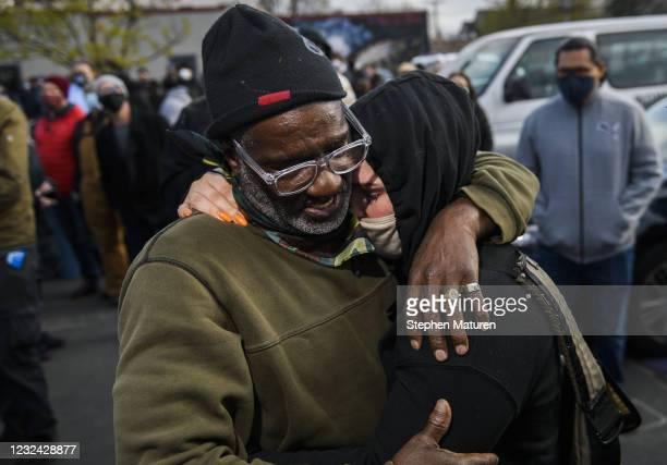 Charles McMillan and Genevieve Hansen, witnesses who testified in the trial, embrace in George Floyd Square after the verdict was read in the Derek...